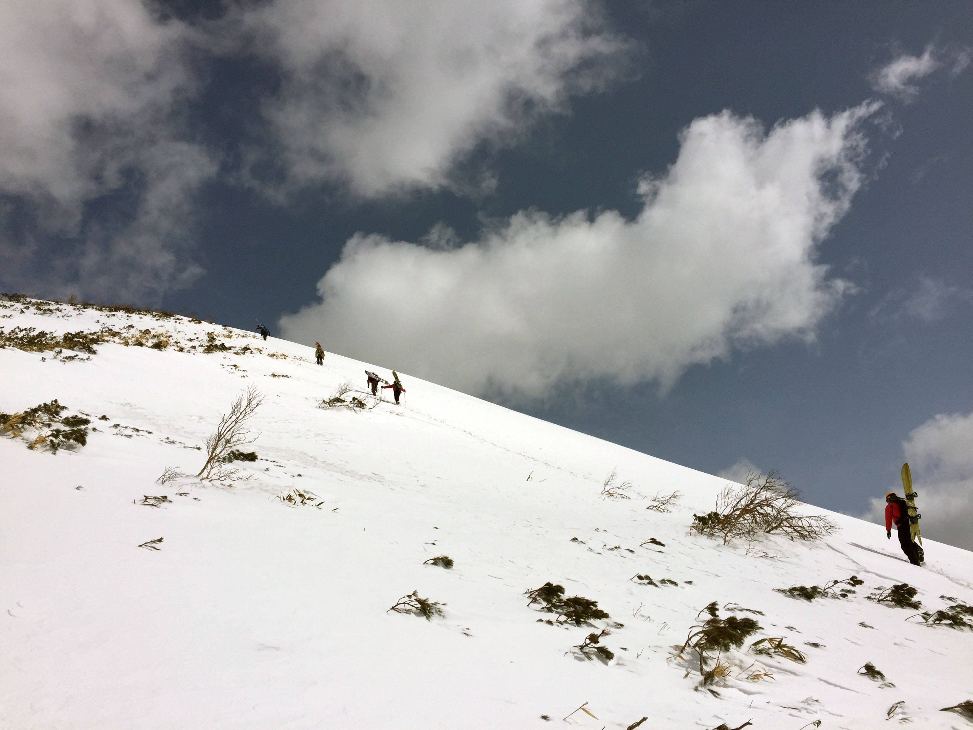 hiking up from the top chair on niseko annupuri