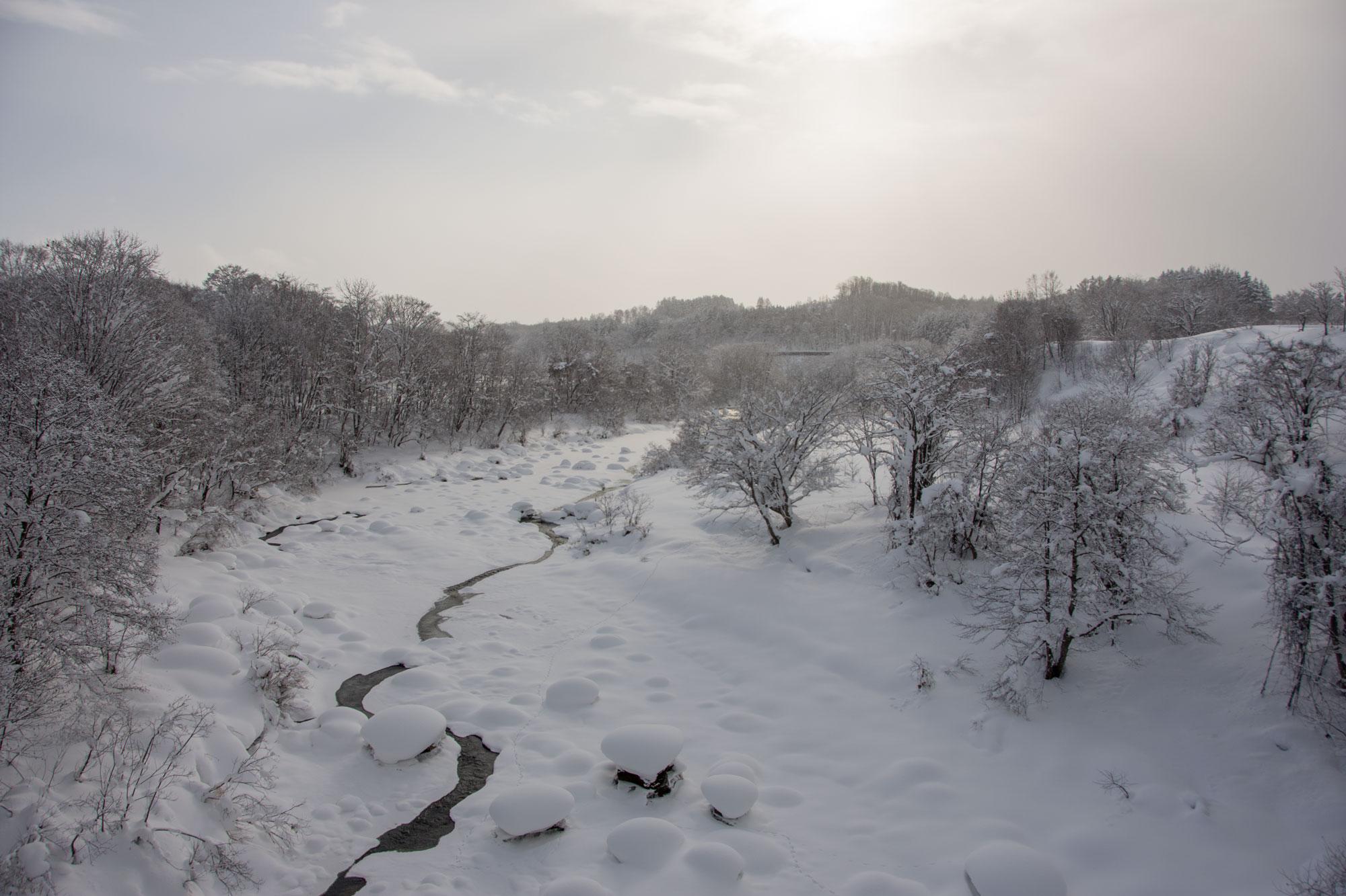 shiribetsu river mid winter in niseko