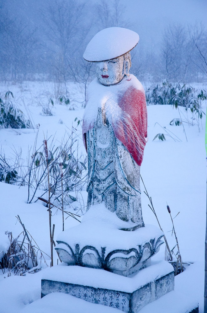 a roadside statue in Niseko