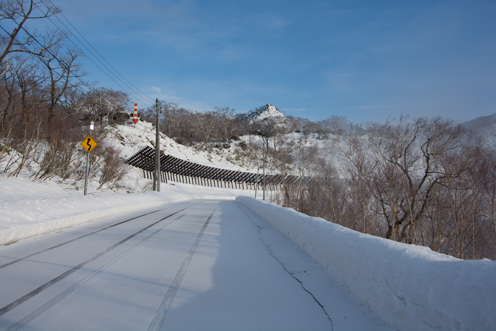 a dusting of snow on the road to Goshiki Onsen
