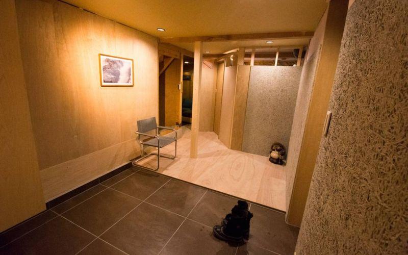 modern wooden ski room in niseko chalet with heated tiled floor