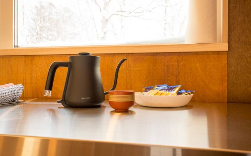 japanese tea cup and modern jug on bench of kitchen