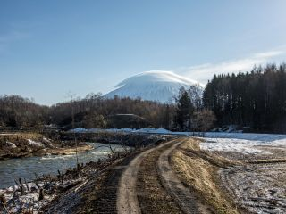 mt. yotei with clouds draped over it peak