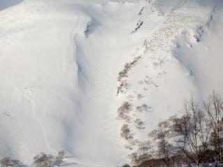 makkari side of Mt. yotei close up with skier tracks and hike tracks